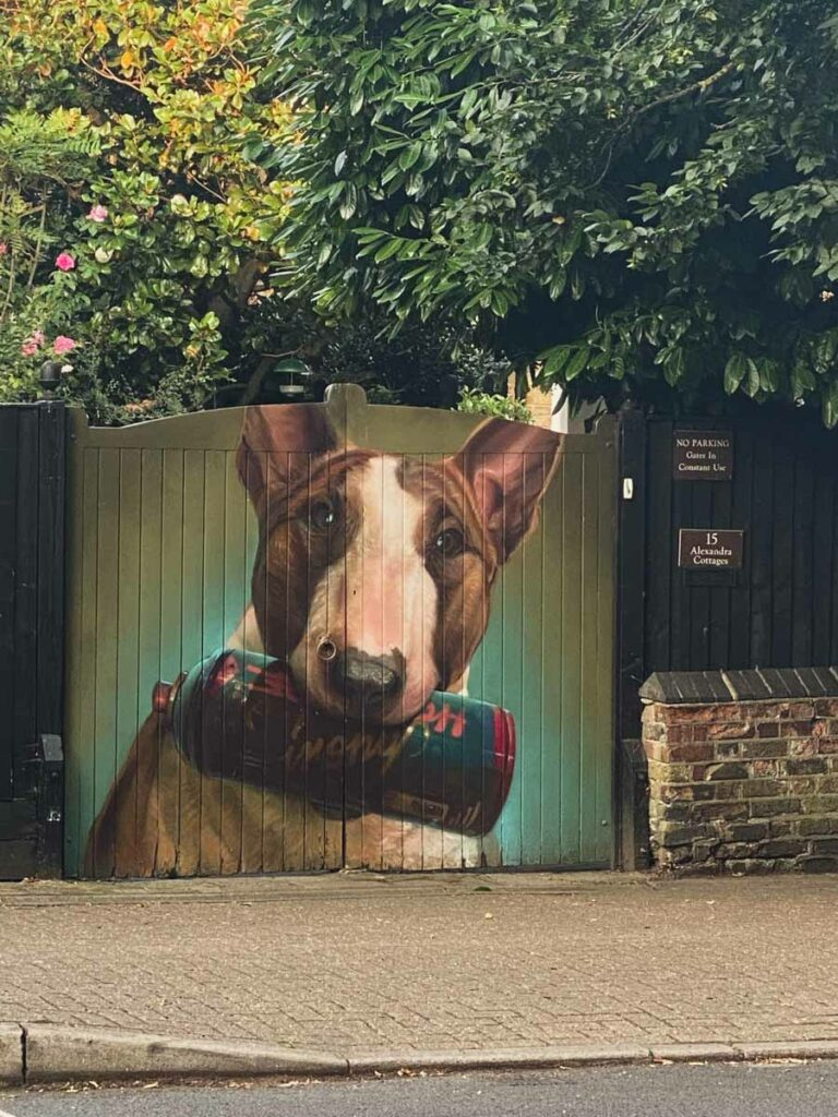 A dog and clutching his spray can by Irony.