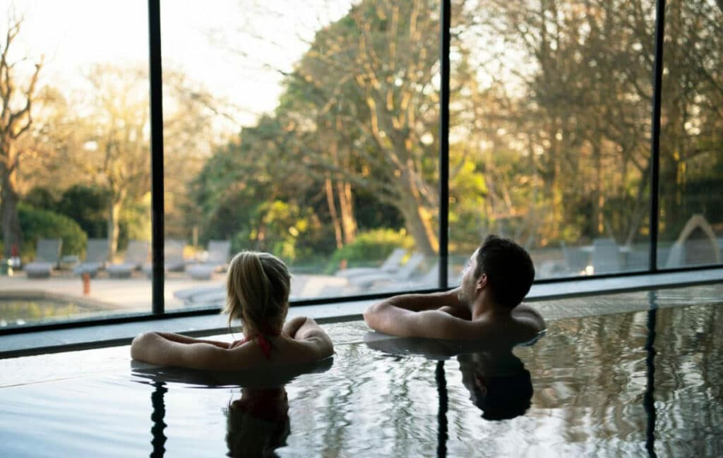 Couple relaxing in the indoor pool at South Lodge
