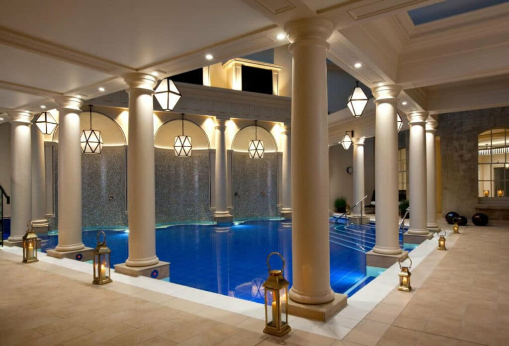 Indoor pool lined with columns at The Gainsborough Bath Spa hotel